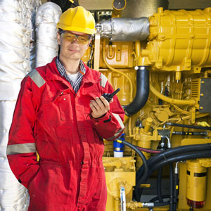 a hydraulics engineer, wearing a red jumpsuit
